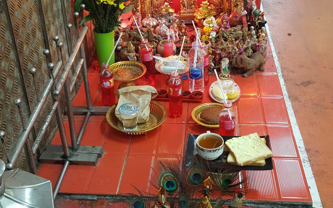 Street shrines in Hong Kong and Bangkok